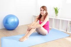 Healthy young woman doing yoga at home Stock Photo