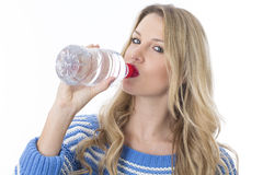 Healthy Young Woman Drinking a Bottle Of Water Royalty Free Stock Images