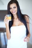 Healthy young woman drinking fresh orange juice Stock Image