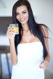 Healthy young woman drinking fresh orange juice Stock Image