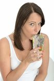 Healthy Young Woman Drinking a Glass of Fresh Iced Water Royalty Free Stock Images