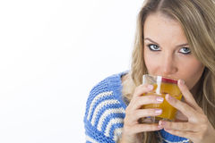 Healthy Young Woman Drinking a Glass of Orange Juice Stock Image