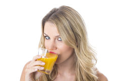 Healthy Young Woman Drinking Glass of Orange Juice Stock Image