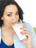 Healthy Young Woman Drinking a Large Glass of Milk Stock Photos