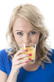 Healthy Young Woman Drinking Orange Juice Royalty Free Stock Photo