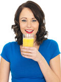 Healthy Young Woman Drinking Orange Juice Stock Photos