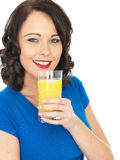 Healthy Young Woman Drinking Orange Juice Royalty Free Stock Images