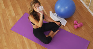 Healthy young woman drinking water after workout Stock Image