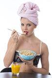Healthy Young Woman Eating Breakfast Cereals Stock Images
