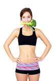 Healthy young woman eating broccoli Royalty Free Stock Photo
