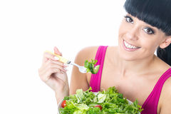 Healthy Young Woman Eating Fresh Salad Leaves with Tomato Stock Photography