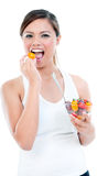 Healthy Young Woman Eating Fruit Stock Image
