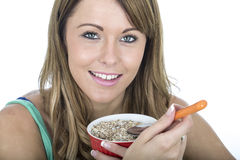 Healthy Young Woman Eating Muesli Royalty Free Stock Images