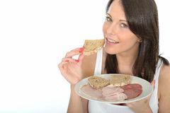 Healthy Young Woman Eating a Norwegian Style Cold Buffet Royalty Free Stock Image