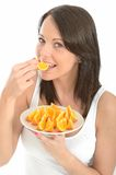 Healthy Young Woman Eating a Plate of Fresh Orange Segments Stock Photography