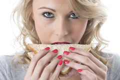 Healthy Young Woman Eating a Sandwich Stock Photography