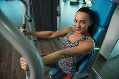 Healthy Young Woman Exercise Chest On Machine Stock Image