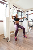 Healthy Young Woman Exercise Chest On Machine Royalty Free Stock Photo