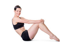 Healthy young woman exercising, isolated on white Royalty Free Stock Image