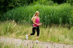 Healthy young woman exercising outdoors Royalty Free Stock Photography