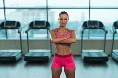 Healthy Young Woman Flexing Muscles Stock Images