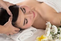 Healthy and young woman is getting spa treatment. Royalty Free Stock Photos