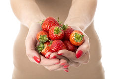 Healthy Young Woman with a Handful of Fresh Strawberries Royalty Free Stock Photo