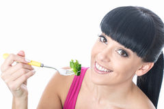 Healthy Young Woman With Healthy Lifestyle Eating Green Salad on a Fork Royalty Free Stock Image
