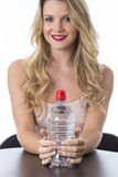 Healthy Young Woman Holding a Bottle of Mineral Water. Attractive Healthy Young Woman Holding a Bottle of  Mineral Water Royalty Free Stock Photo