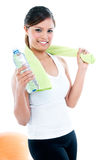 Healthy Young Woman Holding Bottle Of Water. Portrait of healthy young woman holding a bottle of water, isolated on white Royalty Free Stock Photos