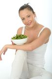 Healthy Young Woman Holding a Bowl of Spinach Stock Image