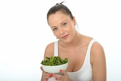 Healthy Young Woman Holding a Bowl of Spinach Royalty Free Stock Images