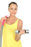Healthy Young Woman Holding a Dumb Bell and Hula Hoop Royalty Free Stock Photos