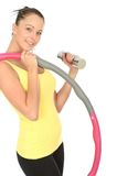 Healthy Young Woman Holding a Dumb Bell and Hula Hoop Stock Images