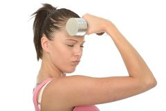 Healthy Young Woman Holding a Dumb Bell Weight to Her Forehead Stock Image