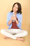 Healthy Young Woman Holding Fresh Bottle of Still Mineral Water Stock Photos