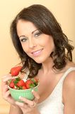 Healthy Young Woman Holding a Fresh Bowl of Strawberries Stock Photos