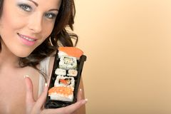 Healthy Young Woman Holding a Fresh Tray of Mixed Fresh Sushi Royalty Free Stock Photography