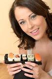 Healthy Young Woman Holding Fresh Tray of Mixed Sushi Royalty Free Stock Image