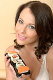 Healthy Young Woman Holding a Fresh Tray of Mixed Sushi Royalty Free Stock Photo