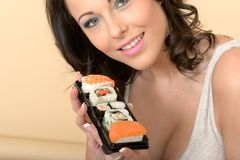 Healthy Young Woman Holding Fresh Tray of Mixed Sushi Stock Photo