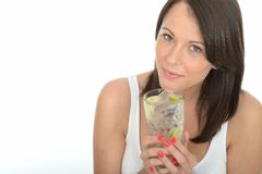 Healthy Young Woman Holding a Glass of Iced Water Stock Photos