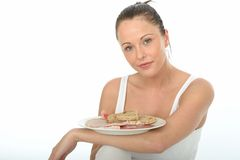 Healthy Young Woman Holding a Plate of Cold Meats Royalty Free Stock Photos