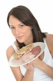 Healthy Young Woman Holding a Plate of Norwegian Style Cold Buffet Royalty Free Stock Photo