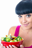 Healthy Young Woman Holding A Red Bowl of Raw Mixed Vegetables. Healthy young woman with hispanic or european features, holding a red bowl of healthy fresh raw Stock Image