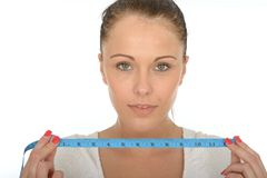 Healthy Young Woman Holding a Tape Measure Stock Image