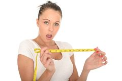 Healthy Young Woman Holding a Tape Measure Royalty Free Stock Photo