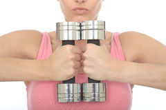 Healthy Young Woman Holding Two Dumb Bell Weights Together Royalty Free Stock Photo