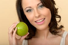 Healthy Young Woman Holing a One Fresh Crispy Green Apple Royalty Free Stock Photos