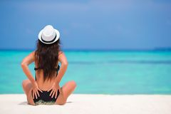 Healthy young woman meditating on the beach Royalty Free Stock Image